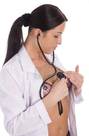 Attractive nurse listens itself chest
