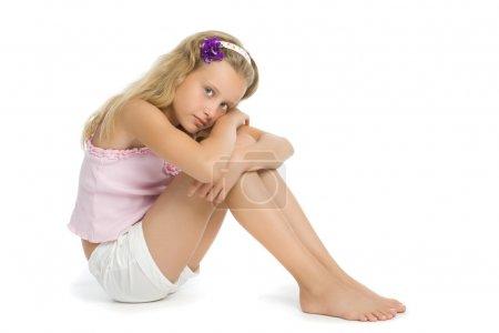 Pretty sad teenage girl sit on floor