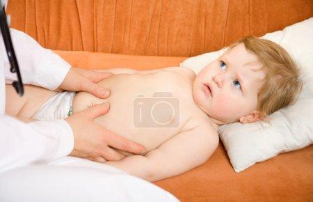 Doctor pediatrician exam baby abdomen