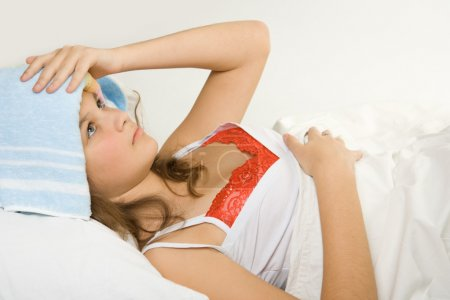 Girl in the bed expressing flu