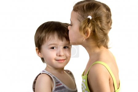 Little girl kisses little boy