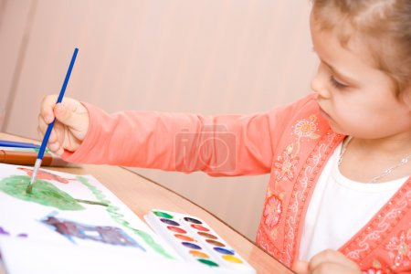 Pretty caucasian child watercolor paint