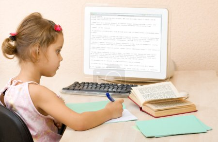 Young girl writing in a notebook