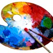 Oval art palette with paints and two brushes on a ...