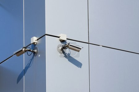Photo for A security cameras on the side of an office building. - Royalty Free Image