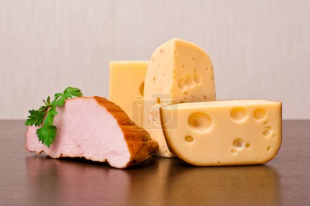 Photo for Three kinds of cheese and smoked ham with parsley - Royalty Free Image