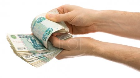 Hands counting roubles