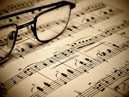 Photo for A closeup of a sheet of piano music and goggles - Royalty Free Image