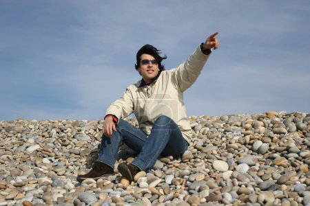 Young Man Gestures at the beach