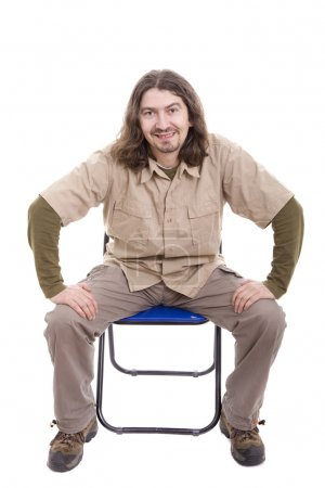 Photo for Young man sitting on a chair, isolated over white - Royalty Free Image