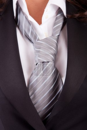 Woman's suit and tie