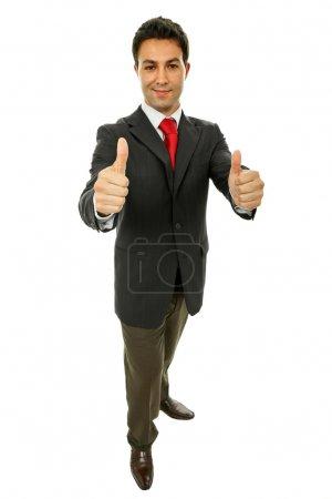 Photo pour Homme d'affaires va les pouces vers le haut, isolé sur blanc - image libre de droit