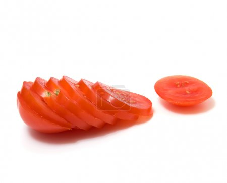 Sliced tomato isolated on white