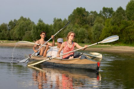 Photo for Peoples travelling on canoe across the river - Royalty Free Image