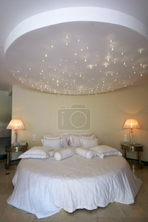 Ceiling like a stars sky over double bed