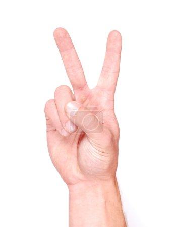 Photo pour Main d'homme montrant deux doigts sur fond blanc - image libre de droit