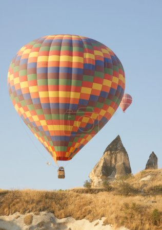 Hot air balloon above a landscape