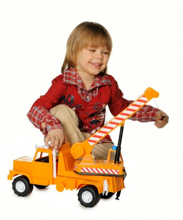 Boy with a toy - a truck crane