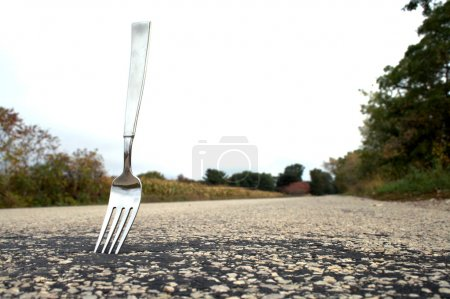 Photo for A fork stuck in the middle of the road. - Royalty Free Image