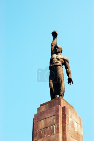 Bronze statue of soviet working man with clenched fist