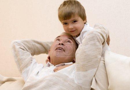 Senior with his grandchild