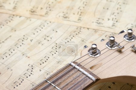 Photo for Neck guitar lies on the old notes - Royalty Free Image