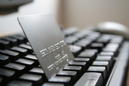 Photo for Credit card over a computer keyboard - Royalty Free Image