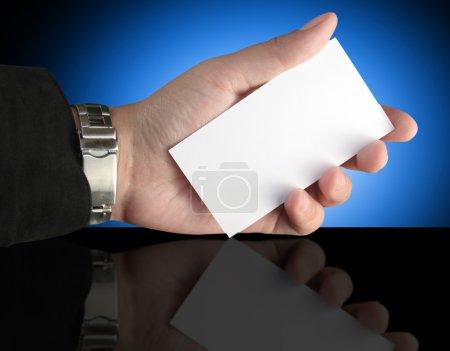 Hand holding blank presentation card