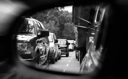 Photo for Black and white image of a traffic jam seen over a mirror - Royalty Free Image