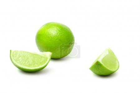 Slice and lime on white background (isolated)...