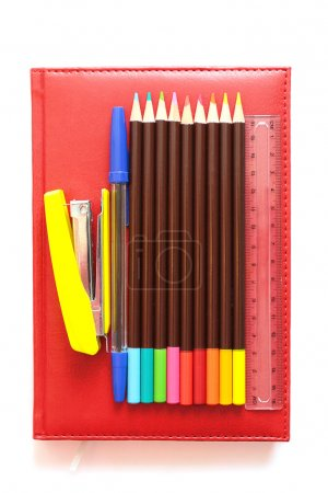 Various office supplies on the book