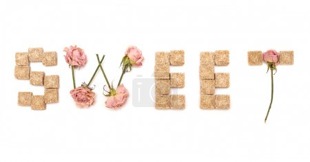 Photo for Text sweet of roses and cane sugar isolated on a white background. Series: Sweet love, sweet dreams - Royalty Free Image