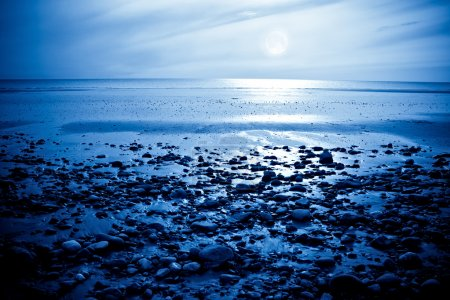 Photo for The rising moon reflected in the ocean from a beautiful bay - Royalty Free Image
