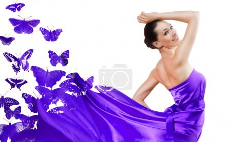 Photo for Beautiful young woman in purple long dress - Royalty Free Image