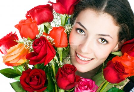Photo for A beautiful girl is near red roses - Royalty Free Image