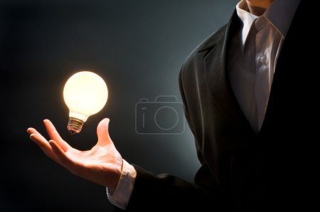 Photo for A man pointing to the illuminated bulb - Royalty Free Image