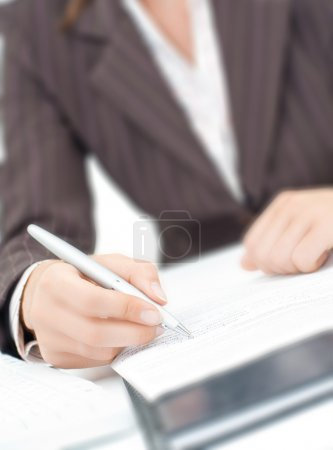 Photo for A secretaryl writing a letter on the paper - Royalty Free Image