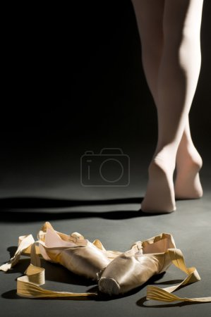 Photo for Ballet schoes on the dark hall floor - Royalty Free Image