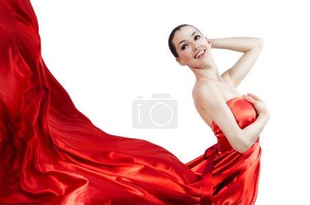 Photo pour Belle jeune femme en robe longue rouge - image libre de droit