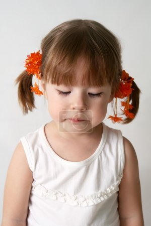 Photo for Small caucasion girl with sad expression on his face. - Royalty Free Image
