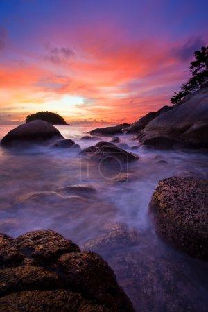 Photo for Tropical sunset on the stones beach. Phuket island. Thailand - Royalty Free Image