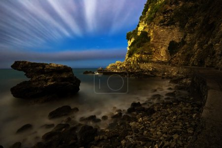 Photo for Night landscape with the sea, the moon and rocks. It is photographed in Montenegro in September. The city of Budva. Adriatic sea. - Royalty Free Image