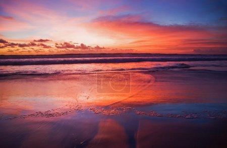 Photo for Sunset on tropical beach. Legian beach. Bali island, Indonesia - Royalty Free Image
