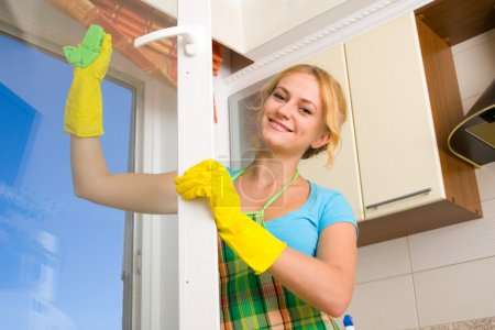 Photo for Women cleaning a window 3 - Royalty Free Image