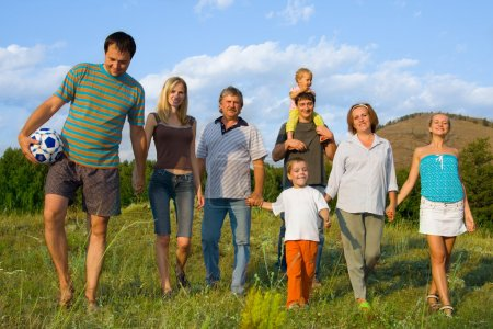 Happy big family on the nature