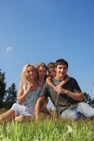 Photo for Happy family with two children in park - Royalty Free Image