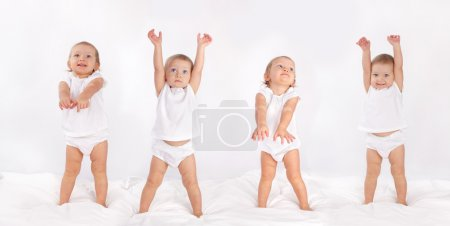 Photo for Beautiful baby dancing on bed - Royalty Free Image