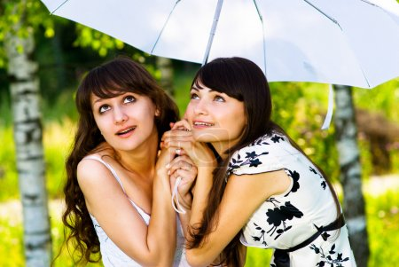 Two girls and an umbrella