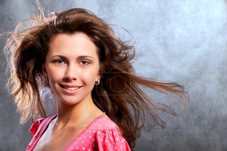 Portrait of dark-haired smiling girl