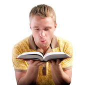 Man blows on opened book